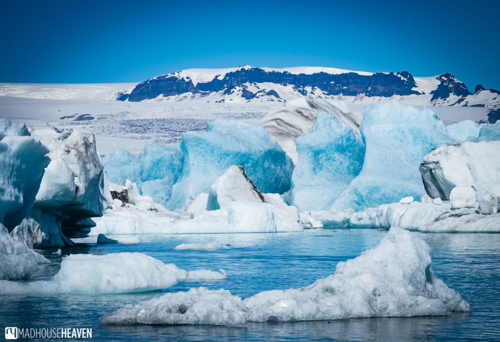 Blue ice icebergs in various shades of blue, reflected in the waters of the Jökulsárlón Glacier Lagoon in Iceland