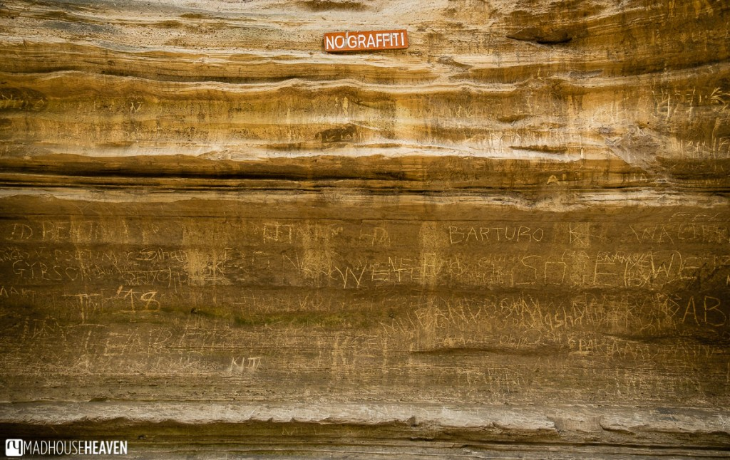 """Graffiti on one of the walls of the Ol Njorowa Gorge in the Hell's Gate National Park, right under the sign saying """"No Graffiti"""""""