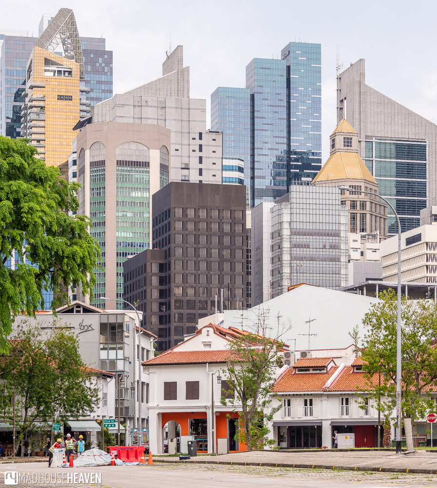 Club Street, with its traditional Chinese shophouses, is backgrounded by shiny skyscrapers behind