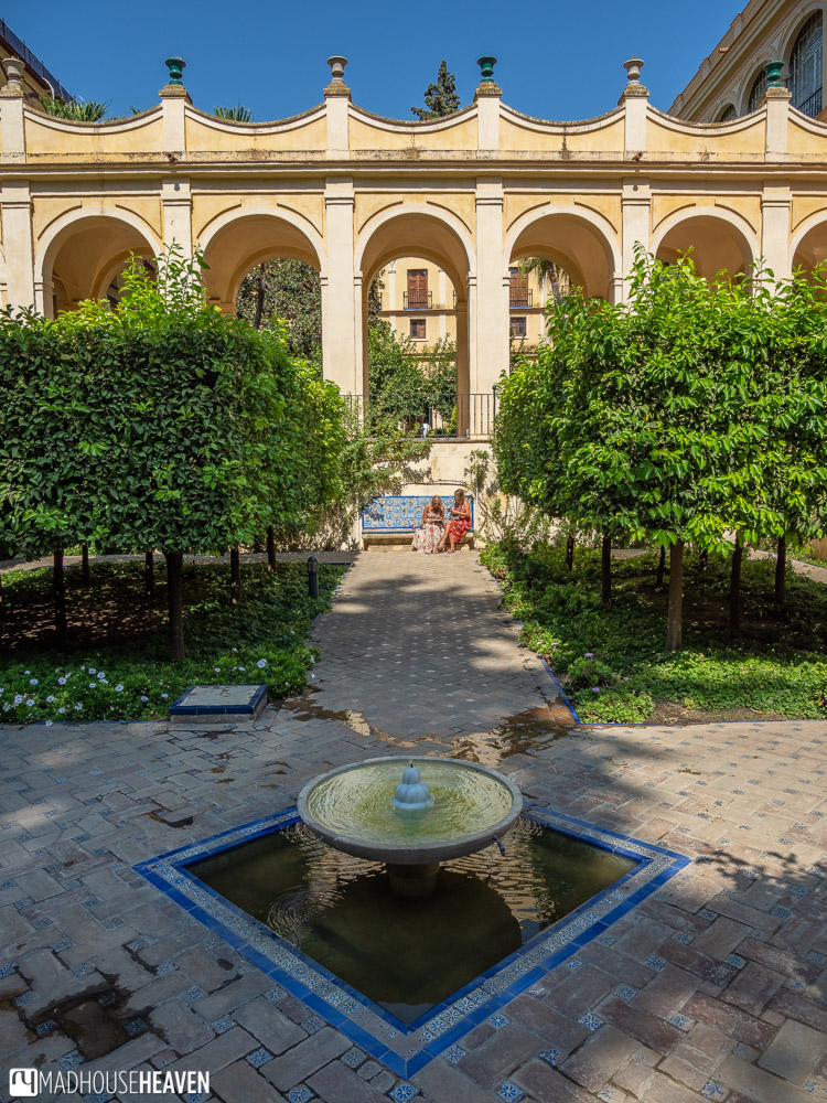 A view of the central fountain in El Jardin Principe, with four passageways intersecting orange groves.