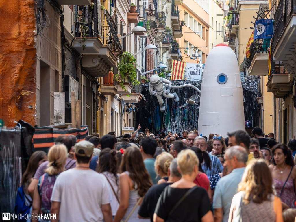 A paper marche astronaut and a rocket at the Gràcia street festival