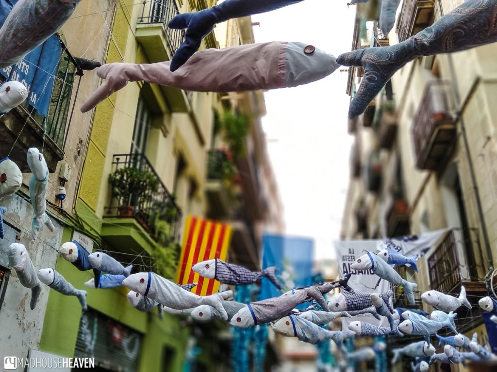A school of handicraft fish 'swimming' over a street