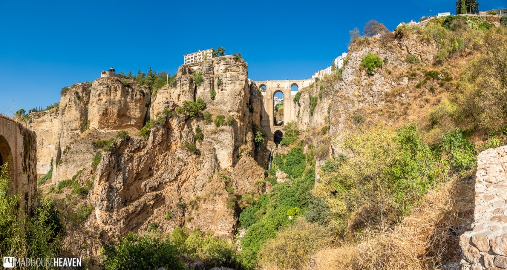 Panorama of the wide expanse of the El Tajo gorge with the Puente Nuevo bridge in the middle