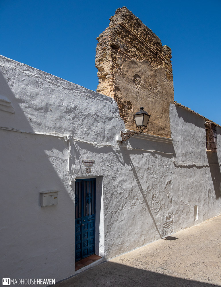 Narrow cobblestone streets and white houses in one of the Pueblo Blancos of Andalusia