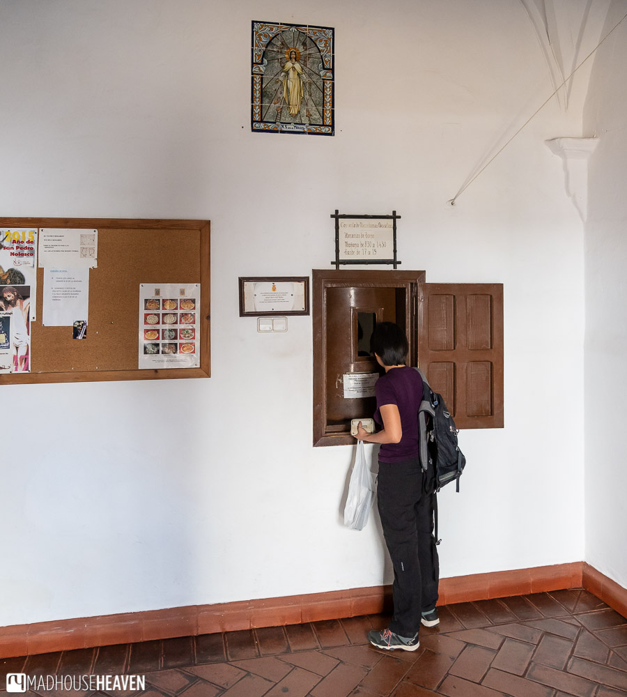 A woman buying sweets in the Comunidad de Mercedarias Descalzas Convent Bakery