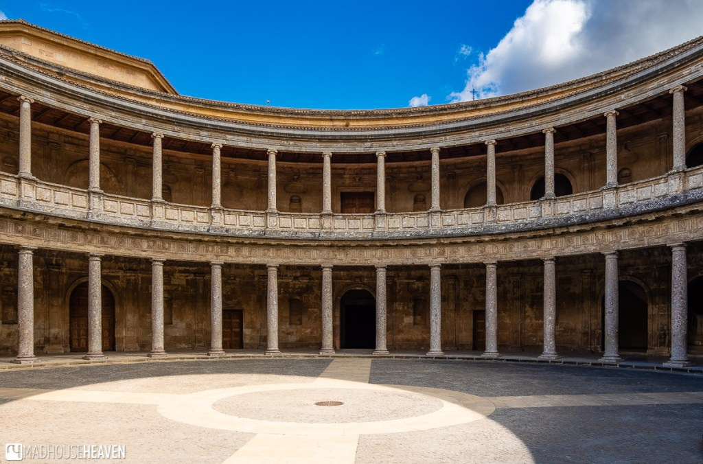 The inner courtyard of the Palacio de Carlos V in Alhambra, with its many columns in two levels
