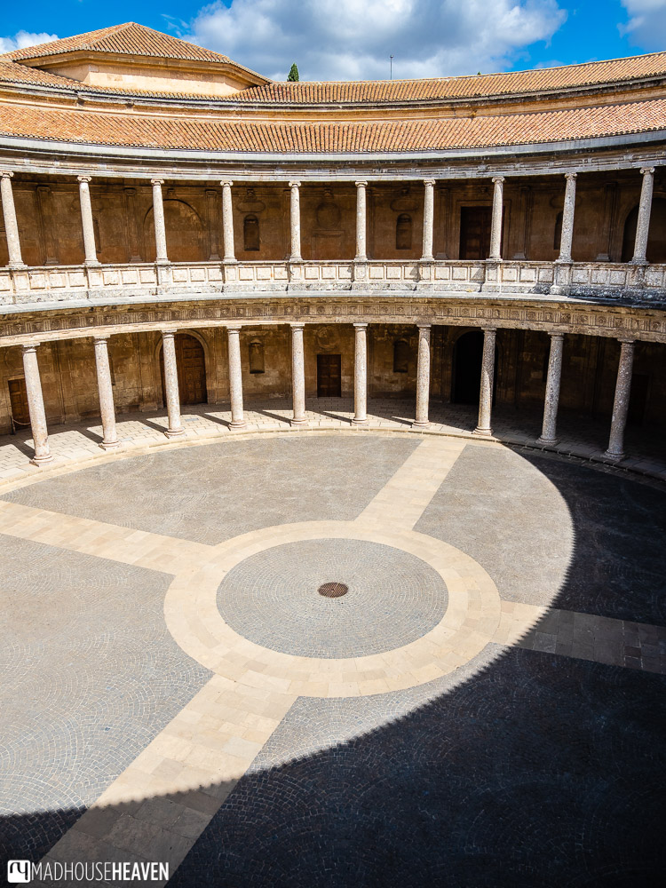 The play of light and shadows in the circular courtyard of the Palacio de Carlos V in Alhambra