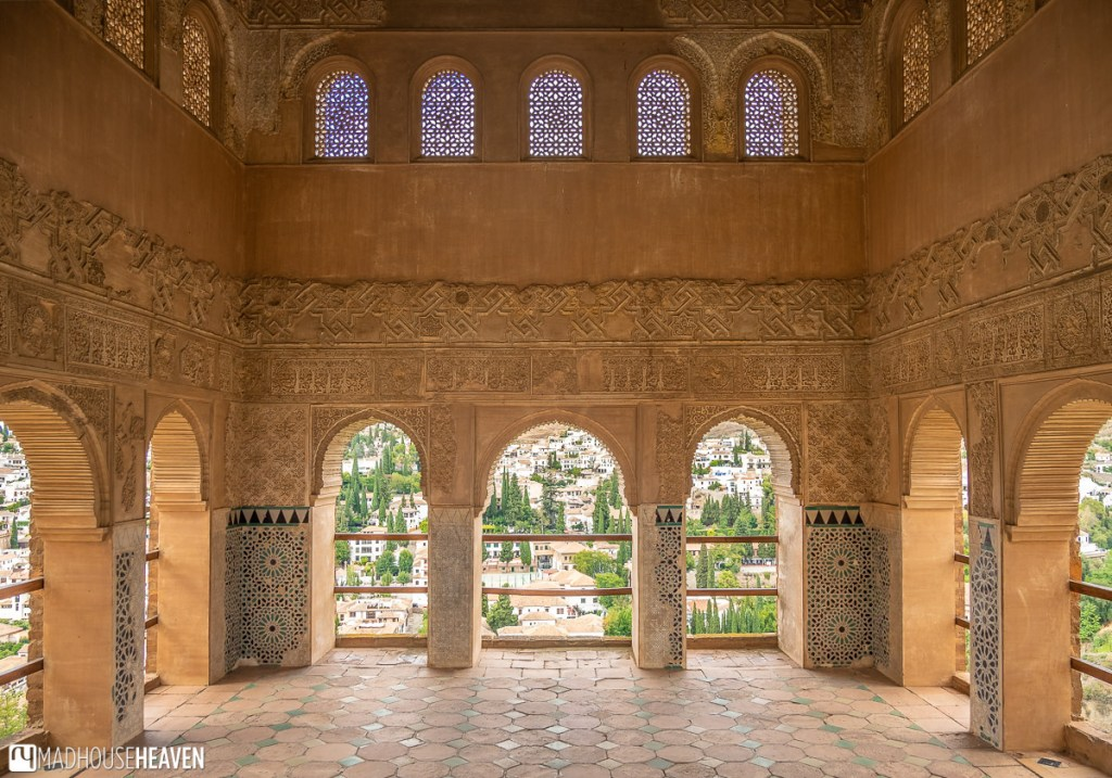 Interior of a Moorish tower in Alhambra with views overlooking the Andalusian countryside.