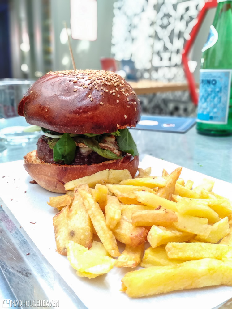 An epic burger with a side of fries