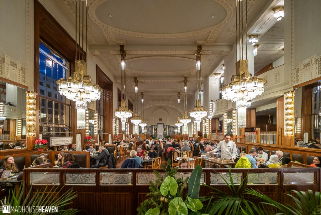 The brightly lit and warm interior of the Municipal House café, one of the Prague cafés that were opened on Christmas eve