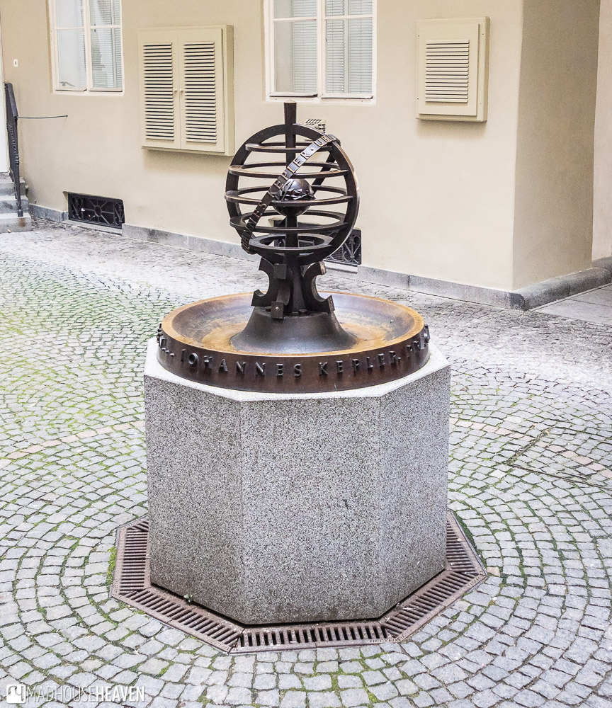 A small bronze statue of modern design commemorating the work of Johannes Kepler, in Prague