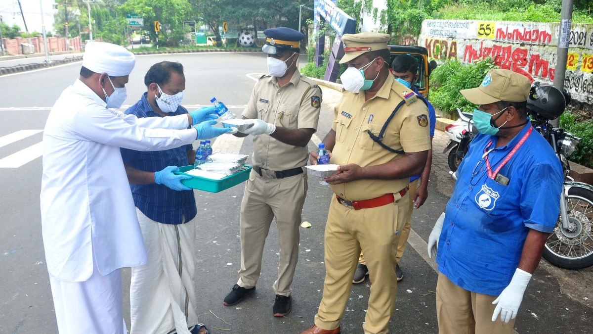 Madin Academy workers distributing lunch to essential staff serving in various locations in the wake of the triple lockdown during covid 19 pandemic.