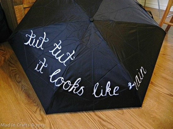 hand-paint-the-quote-on-umbrella_thu