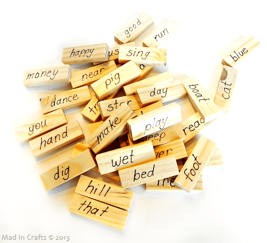 pile of Jenga blocks with words written on them for a reading game