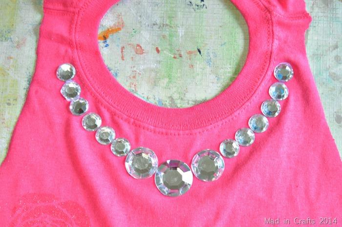 Rhinestone necklace on smock