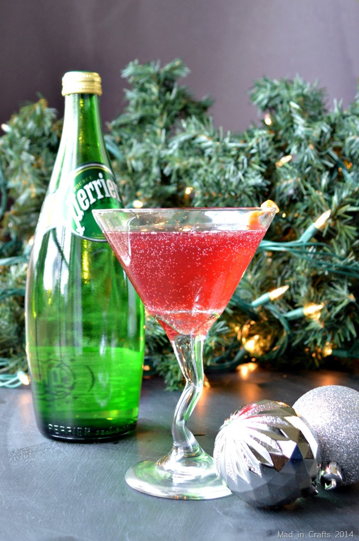 martini glass, christmas ornaments and a perrier bottle