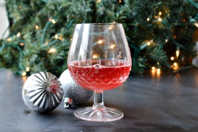 red mocktail and christmas ornaments