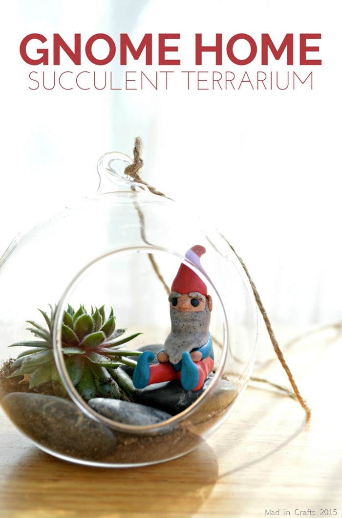 Make a Gnome Home Succulent Terrarium. Isn't that little gnome the cutest!!!