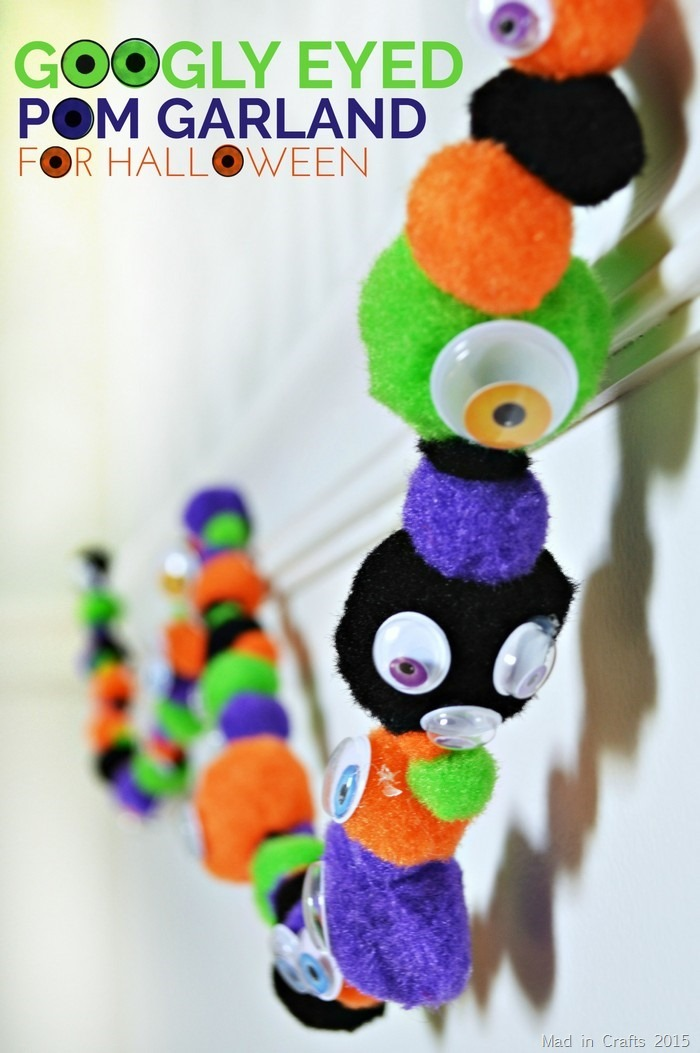 close up of a pom garland with googly eyes