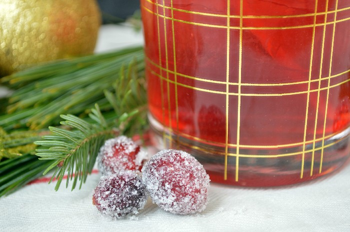 sugared cranberries next to cranberry cocktails