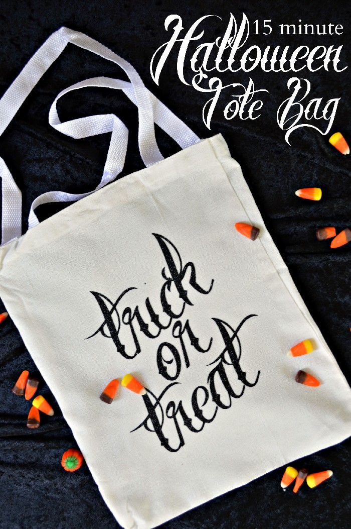 trick or treat tote bag and candy corn on a black background