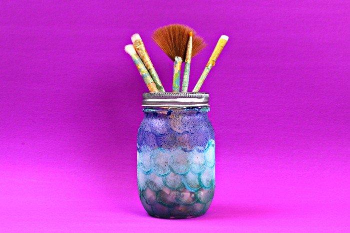 mermaid scale painted mason jar on a purple background