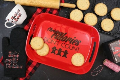 red tray with vinyl Christmas Calories Don't Count next to cookies and a rolling pin