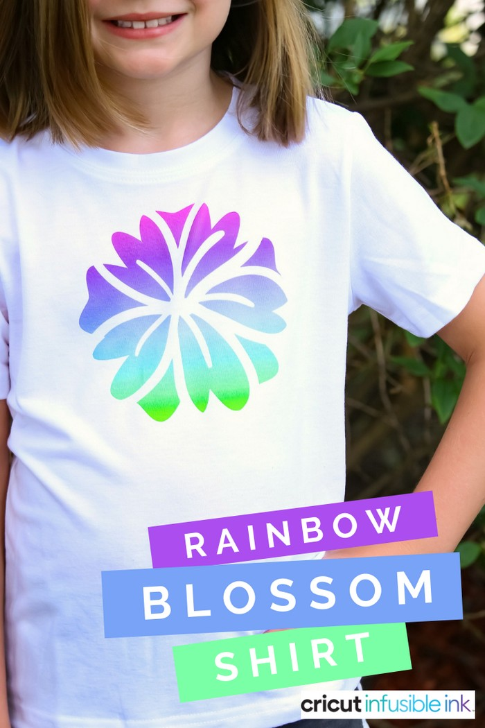 Girl wearing a white t-shirt with colorful infusible ink flower