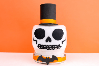 skull painted mason jar on an orange background