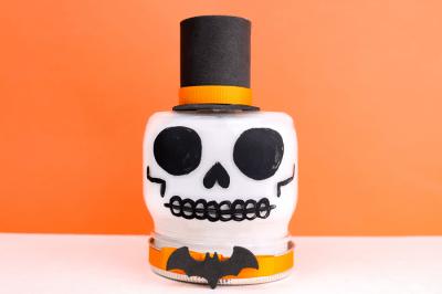 skull painted mason jar on an orange background