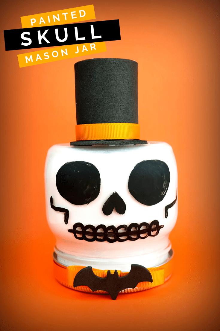 Mason jar to look like a skull on an orange background