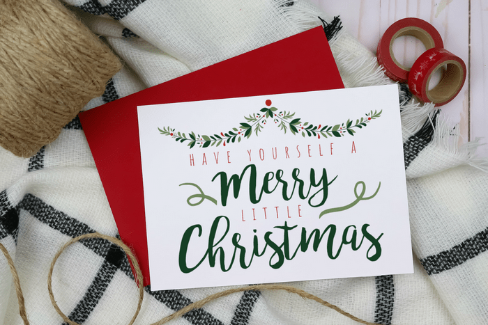 Farmhouse style Christmas card on a red envelope with twine and washi tape