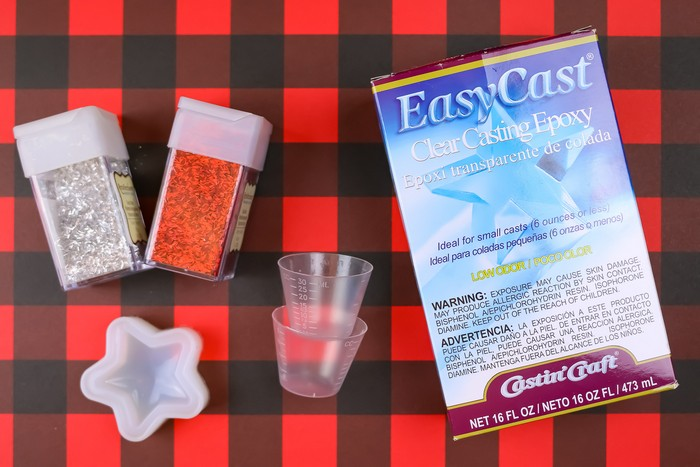 Casting epoxy supplies on a plaid background