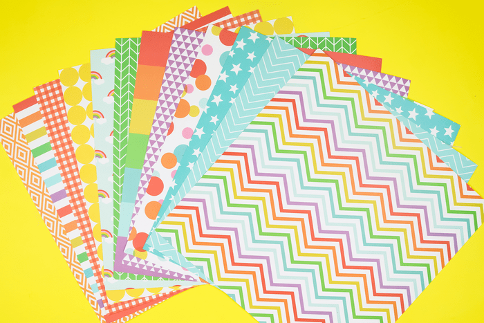 colorful scrapbook paper on a yellow background