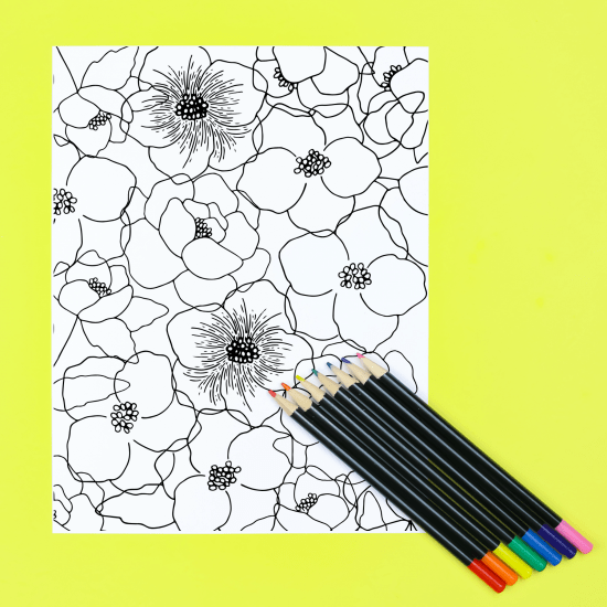 coloring page with colored pencils on a yellow background