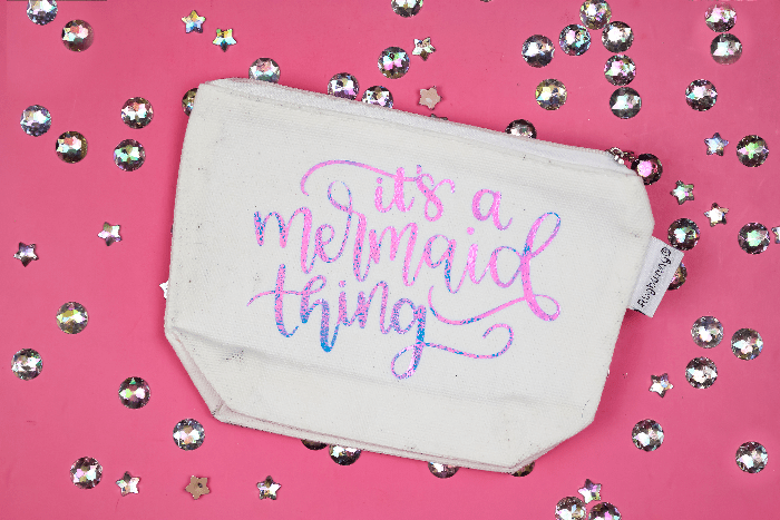 zipper pouch with a vinyl design that says it's a mermaid thing on a pink background with rhinestones