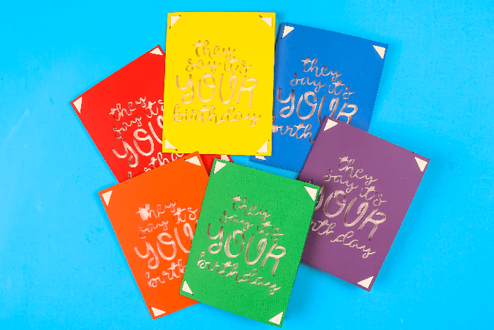 colorful They Say It's Your Birthday Cricut insert cards on a blue background