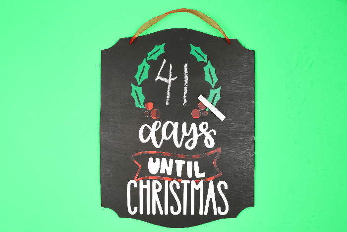 Chalkboard Days until Christmas sign with a piece of chalk on a green background