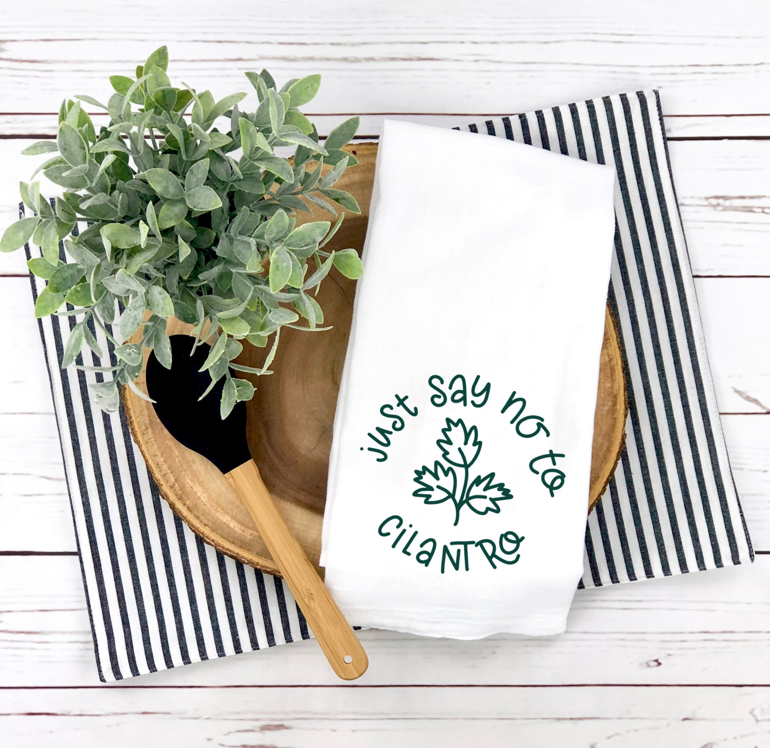 """white """"just say no to cilantro"""" kitchen towel with placemat and bowl"""