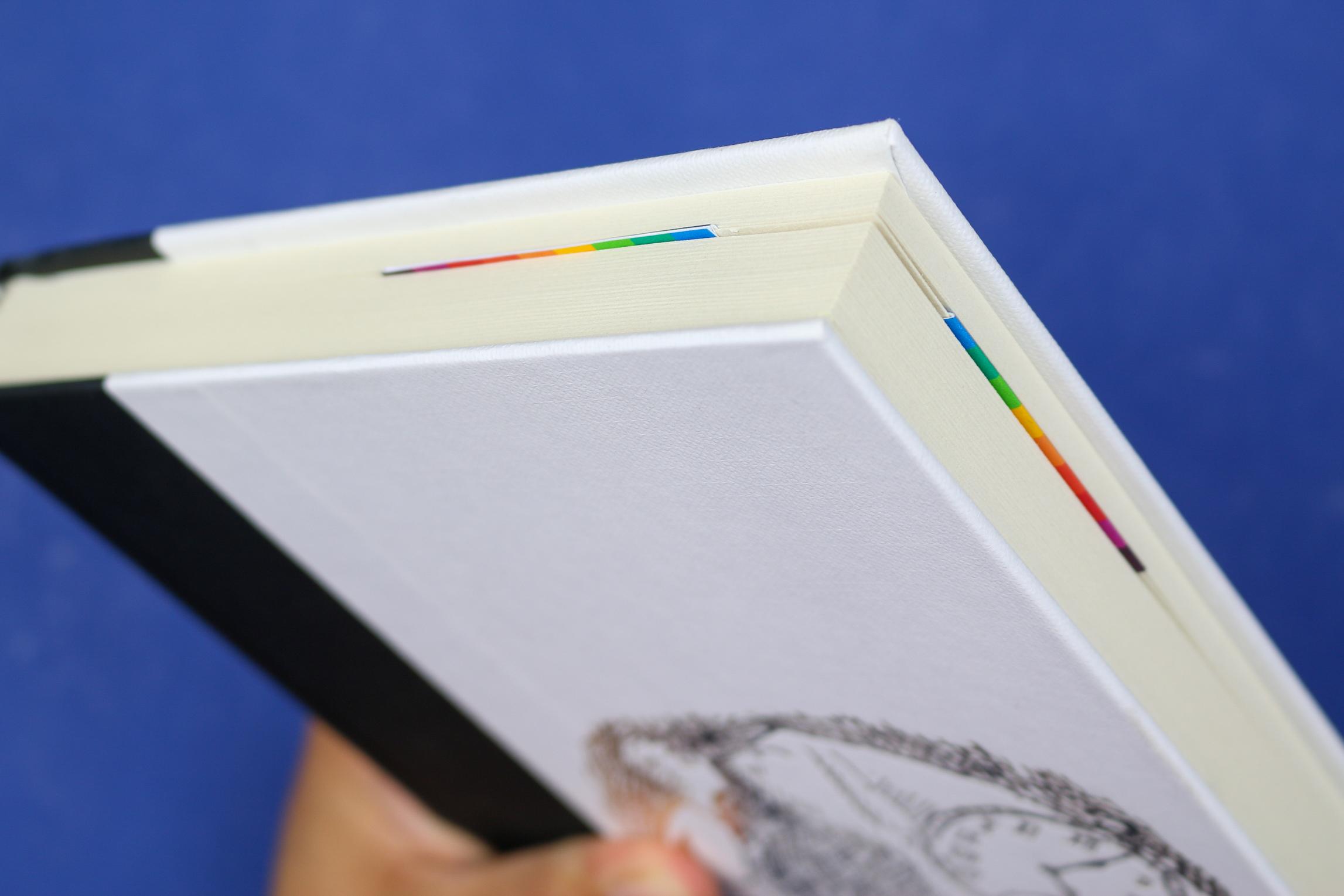 Rainbow Corner bookmark in a white book