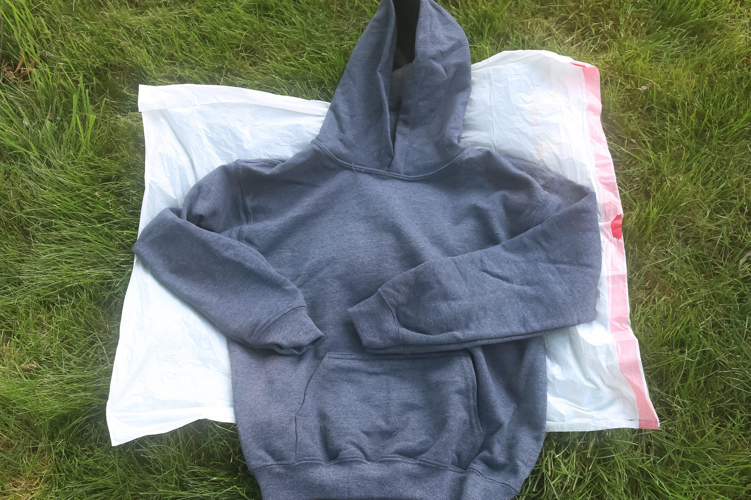 grey hoodie on a plastic sheet