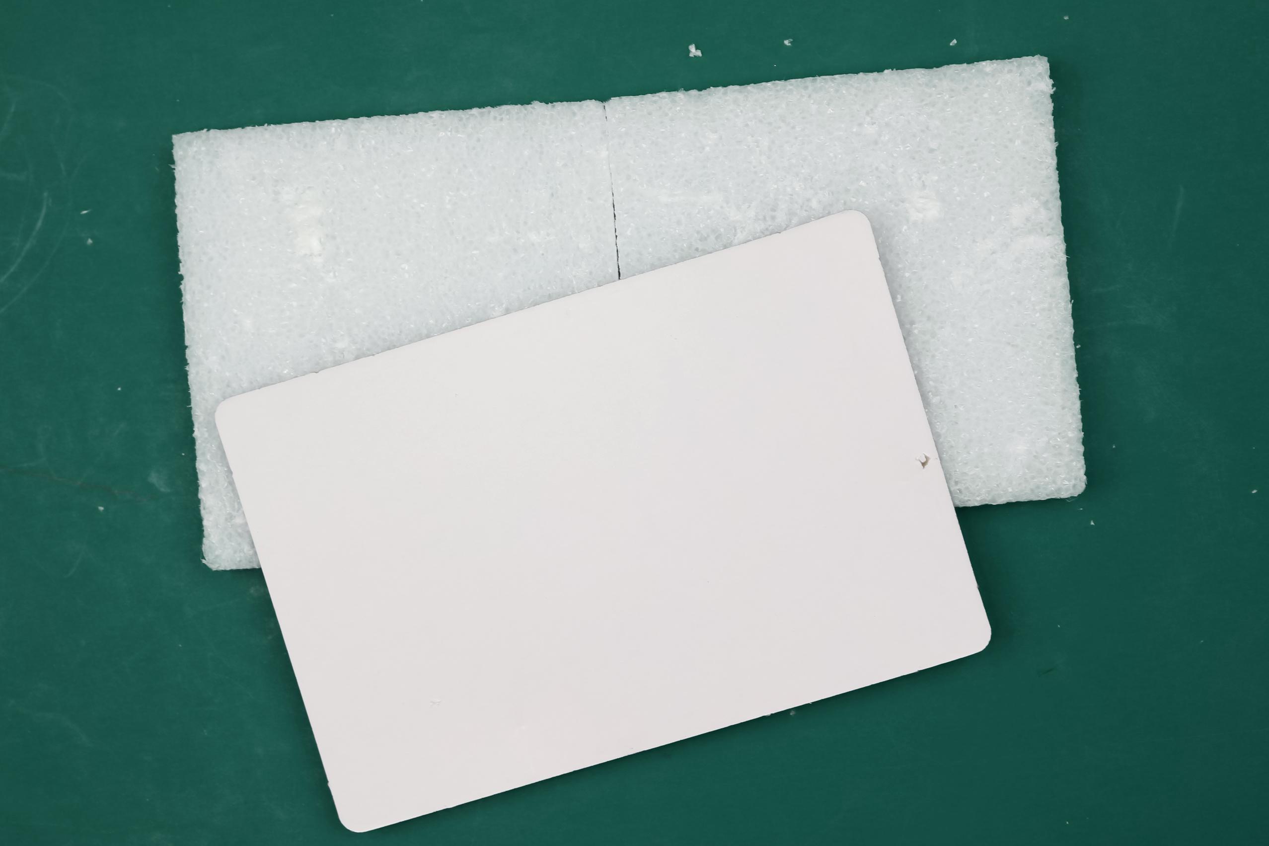 White styrofoam on a green background