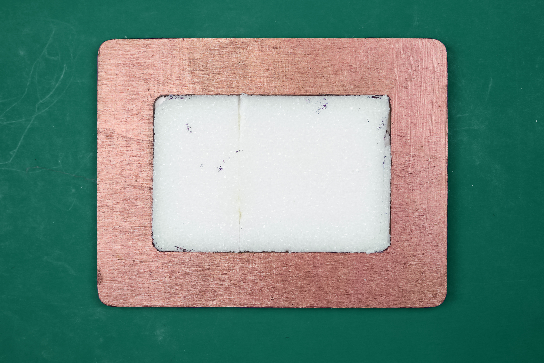 white styrofoam in a copper frame