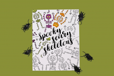 Spooky Scary Skeletons coloring page surrounded by plastic bugs