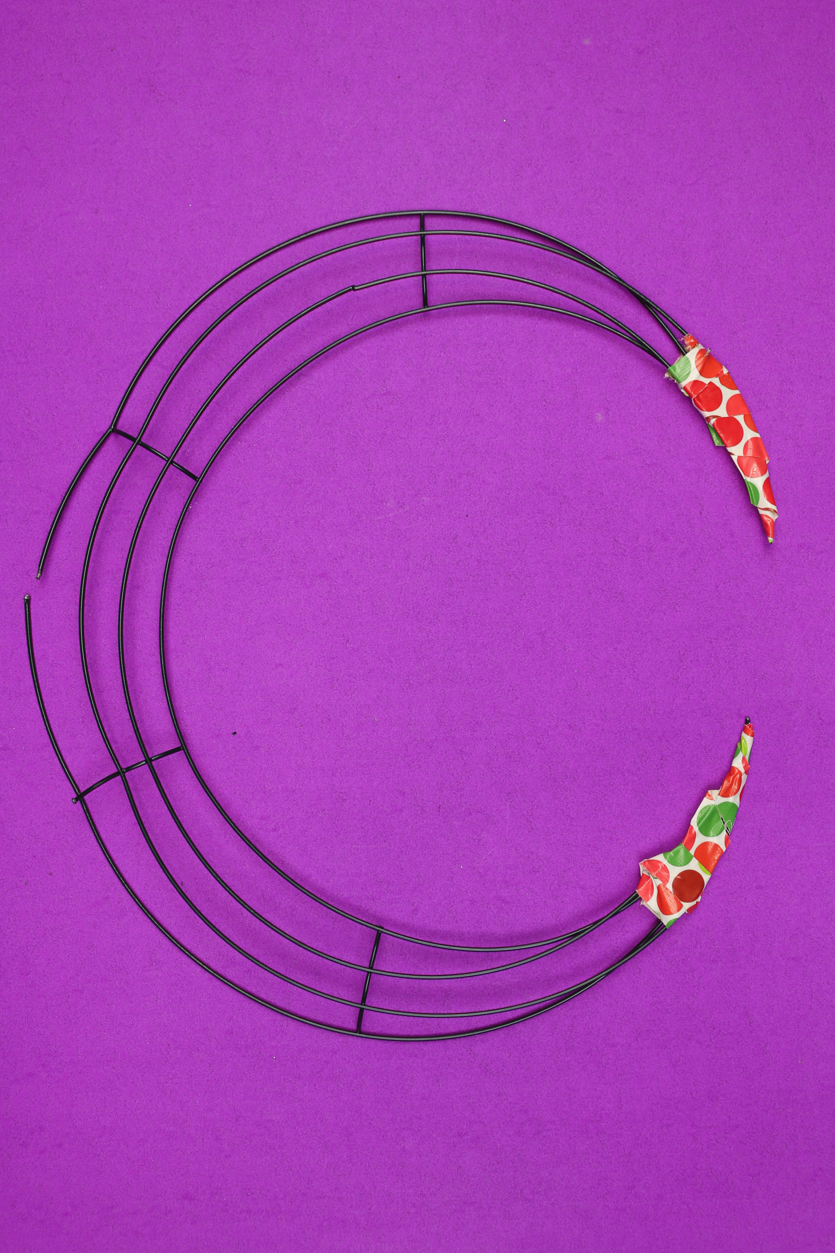 dollar store wire wreath form cut into a crescent