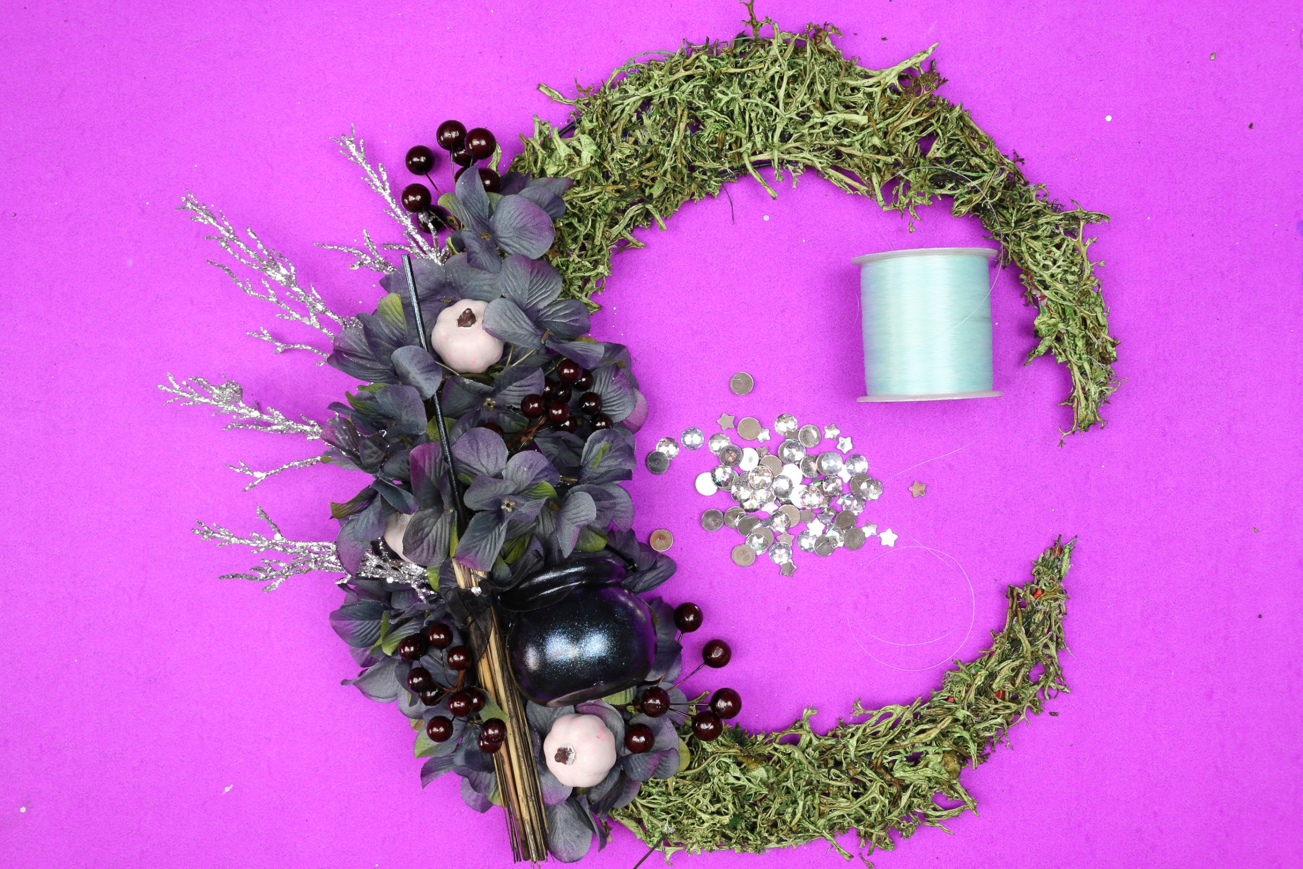 floral crescent moon wreath with fishing line and gems