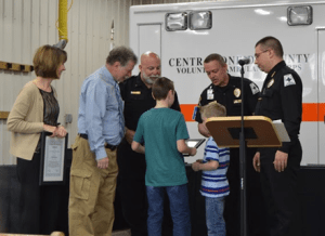 Bryan Hill presents the Life Saving Award to Clinton High School nurse Mary Beth King and the family of Jace Janczewski.  In August of 2015, Mary Beth King and the COCVAC crew provided CPR and other life-saving interventions to Bryan Hill, after he collapsed at Clinton High School.  In typical EMS fashion, Jace Janczewski was not available to receive the award due to being on an EMS call.