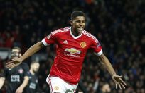 United's Marcus Rashford celebrates after scoring during the Europa League round of 32 second leg soccer match between Manchester United and FC Midtjylland in Manchester, England, Thur, Feb. 25, 2016 . AP Photo:Jon Super