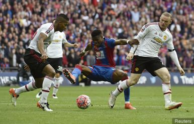 Mourinho . Crystal Palace's Wilfried Zaha in action with Manchester United's Wayne Rooney and Antonio Valencia