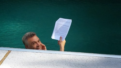 Picture of famed photographer Frederic Brenner reading Madlik blog